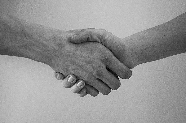 HVAC Maintenance Plan with a handshake